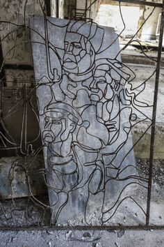 Comrades - Metal artwork depicting Soviet workers - probably a stained glass window once. This is located in the control centre of the abandoned Duga-3 radar station near Chernobyl.