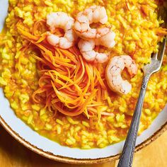 This gorgeous risotto recipe starring carrots and shrimp is easy to make and the perfect fall dish to cozy up to. Arborio Rice, My Favorite Food, Favorite Recipes, Shrimp Risotto, Valeur Nutritive, Large Shrimp, Fall Dishes, Risotto Recipes, Gourmet