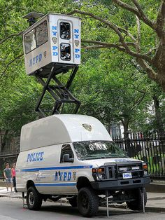 This New York Police Department Mobile Utility Surveillance Tower can be fully deployed by one person at any location in less than two minutes without leaving the vehicle. July 8, 2014.