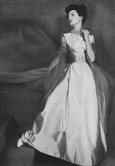Joanna McCormick, March Vogue 1957    Wearing Jean Patou's pale ice blue satin gown folded at the bust and hip, trailing a huge cloudy scarf of a deeper blue organdie.