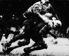 Photographer/Creator  J. Bruce Baumann  Collection  1970  Publisher  Grand Rapids Press  Caption/Description  Football game played in the snow.