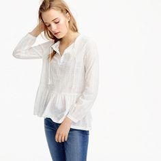 "An easy throw-on-and-go top in a textured clip-dot cotton with a relaxed peplum hem is what every closet needs. <ul><li>Body length: 25 1/4"".</li><li>Cotton.</li><li>Bracelet sleeves.</li><li>Machine wash.</li><li>Import.</li></ul>"