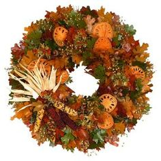 """Wreath with faux maple leaves and corn in a natural twig base.  Product: Faux wreathConstruction Material: Silicone and twigColor: MultiFeatures: Designed with maple leaves,  strawflowers, flax, quinces, corn and faux acornsDimensions: 22"""" DiameterCleaning and Care: Wipe gently with a dry cloth"""