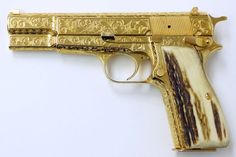 Browning Hi Power 9mm Para caliber pistol. Fantastic custom engraved and gold plated model with full coverage scroll and genuine Stag grips.