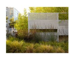 andrea cochran - perforated corrugated metal screen wall