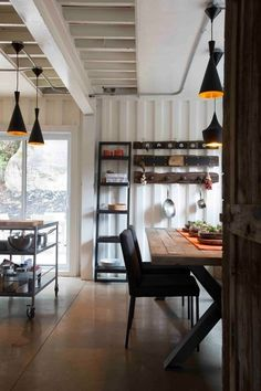 Love the natural wood with the industrial look of the container.  Mix of white walls with warm wood