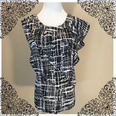 Michael Kors Top Black and white 100% polyester in excellent condition! Size 12 MICHAEL Michael Kors Tops Blouses