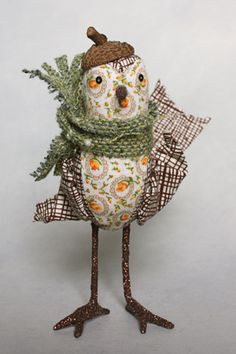 Love the acorn hat, just the right size for this bird.