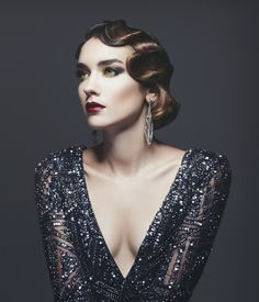 With a deep side part and glossy curls, this down-do pretty much epitomizes old-Hollywood glamour. It's a guaranteed winner for formal holiday affairs. To get the look: Start with a deep side part and dry hair. Then apply a generous helping of strong-hold mousse, and use the length of your fingers to pinch one-inch sections of hair perpendicularly down the length of your strands. Clip each pinch and spray with strong-hold hairspray to set the style.