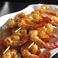 Honey Grilled Shrimp ***Amazing taste!  I brined the shrimp for 25 min in a mix of 1/4 c kosher salt and 1/4 c sugar in 2 cups water before sticking in the marinade for 6 hours.  Rinse after brine.  Used only 1/4 of the worcestershire sauce it called for and skipped it completely in the marinade.  The extra basting honey butter sauce was served on the side to dip in.  So so so good!**