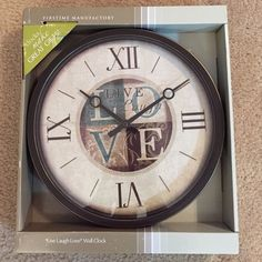 """""""Live Laugh Love"""" Wall Clock This has dark brown, blue and tans in it. Never used. It was a gift, but it doesn't go with the rest of my decor. Other"""