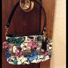 "NEW ITEM NWT BUTTERFLY COACH WRISTLET NWT Coach Butterfly bag small size 10"" L 6.5"" H 3"" Wide. My daughter is 8 yrs olds so she's the cute model being used. Used for 2 hrs kept in a plastic it came in very cute & still brand new condition. Figured I used more but didn't & it's been sitting 4 @ least 8 months. Gr8 4 the very small necessities or 4 a teenage girl. Bought off posh from an awesome posher. All reasonable offers will b considered low 1's ignored. TRADESPAYPALLOWBALL OFERS Thanks 4…"