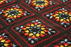 This was created with a 4.5mm hook, lots of acrylic and the pattern was the stained glass afghan by Melody McDuff from 50 Sensational Crochet Afghans.