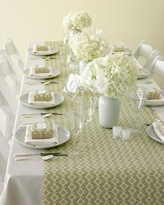 Wrapping-Paper Table Runner - Use leftover holiday wrapping paper as a sophisticated table decoration - great idea!