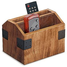 Don't lose track of all of your remote controls. Instead, use the Wood Remote Control Caddy to keep all of you remotes organized and ready for action at the drop of a hat. It's stylish to boot, with a nice oak finish and neat metal accents.