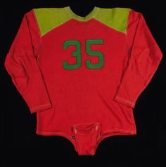 Vintage football jersey c.1920-30s. Colorful red and green wool jersey has an applied green #35 on both front and back. $275