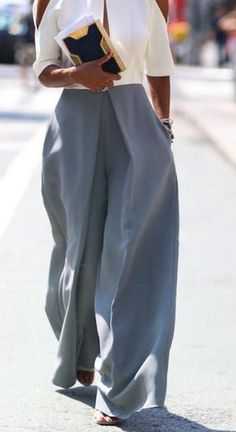 Wide Leg Pants is very popular nowadays.This loose style pant is very popular now,which can make you leg look much slimmer and you can also be looked elegant,you can wear it at your free time,get one
