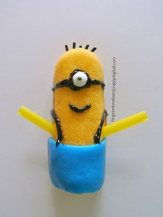 Fun Minion Treat For Kids- Twinkies, black sprinkles, black gel, blue airheads, candy eyeballs, and yellow straws.