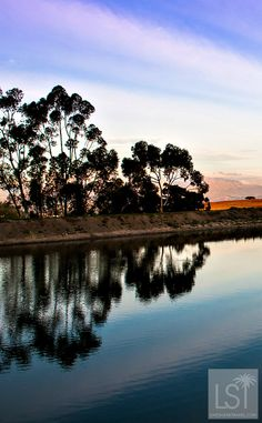 Sunset over the lake at Jordan's Wine Estate, in Stellenbosch, in South Africa's Western Cape. This beautiful region is the scene of many fascinating wine and travel stories.