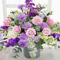 An enchanting flower display exquisitely presented featuring pink Roses, lilacs, purple Stocks with lilac Carnations and delicately fragrant Freesias Easter Flower Arrangements, Beautiful Flower Arrangements, Flower Centerpieces, Floral Arrangements, Funeral Flowers, Wedding Flowers, Church Flowers, Amazing Flowers, Beautiful Flowers