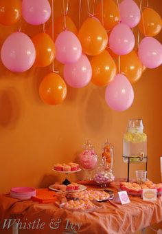 Interesting back drop - Balloon arrangements with a weight in them