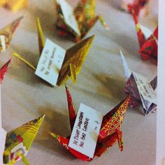 Origami cranes - cute idea for a large dinner party for place settings