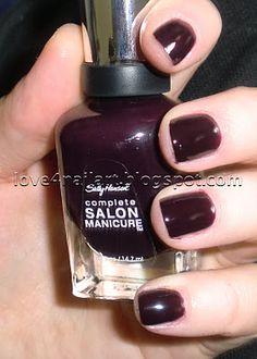Pat on the Black, Sally Hansen. My favorite nail color. It's a dark plum.