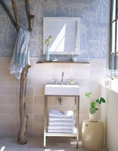 Nice idea for a white or light colored bath...perhaps more branches (cut short?) to hang more. 52 Ideas To Use Driftwood In Home Décor | DigsDigs