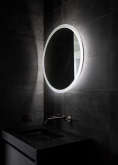 A graphite-finished Waterworks faucet sits below the mirror. Lilac Bathroom, Brown Bathroom, Simple Bathroom, Bathroom Sets, Modern Bathroom, Bathroom Mirrors, Bathroom Lighting, Large Bathrooms, Minimalist Interior