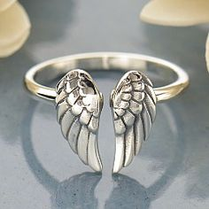Sterling Silver Adjustable Wing Ring. Angel wings can be a symbolic channel facilitating communication between you and your own idea of the divine. This ring, with its beautifully detailed feathers, would look fabulous on its own