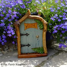 Such a pretty fairy door - I love the color - so fitting in the garden, and the little fern leaves - I need to find miniature hinges like these - barn door style (inspiration only) **************************************** The Fairy Kingdom #fairy #garden #miniature #door