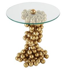 An urban sculpture of stacked brass finished spheres perfectly suspends a floating tempered glass top creating a whimsical table for all occasions. The warm glow of the brass finish complements the quirky silhouette of the piece. Restaurants, Vase With Lights, Oversized Wall Art, Drink Table, Home Office Decor, Minimalist Home, Table Furniture, Contemporary Furniture, End Tables
