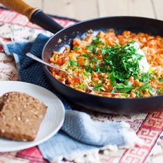 Menemen   This traditional Turkish breakfast item is scrambled eggs cooked in sautéed vegetables and served hot with bread. Dip it, spread it, or spoon it up.
