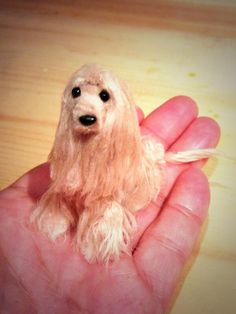 I tried to make the Afghan hound using wool and pipe cleaner
