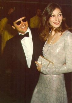Jack Nicholson with Anjelica Huston in beaded fishscale patterened dress at the 47th Annual Academy Awards, 1975