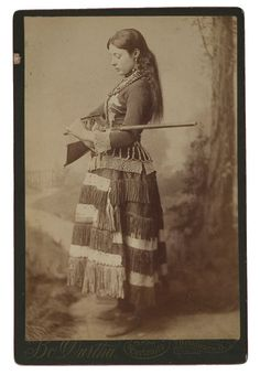 c.1870-90's, portrait of sharpshooter,  Bo Durtha, with her a single shot tip-up rifle and a mirror for over-the-shoulder trick shooting.  *s*