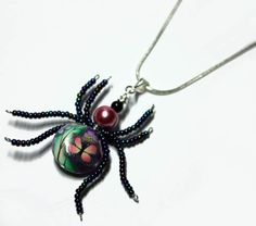 Beaded Spider Wire Wrapped  Polymer Clay Butterfly by Nixcreations, $27.99 - This pendant is wire wrapped in nontarnishing silver wire. The flower bead is made from polymer clay.    Pendant measures 2 x 2.5 inches