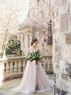 Blush tulle wedding gown in a romantic old-world setting. #weddingphotography #bridalportraits