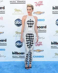 At the 2013 Billboard Music Awards, she wore a busy jumpsuit that was very on brand for the new Miley.