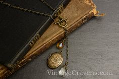 Clear & Amber Crystal Antique Brass Locket Lariat Necklace by VintageCravensToo