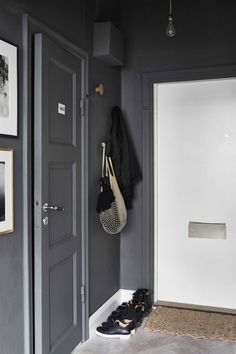 Tiny Studio Apartment With Big Style - Gravity Home Entry Stairs, Entry Hallway, Entryway, Dark Grey Hallway, Decoration Hall, Tiny Studio Apartments, Ideas Prácticas, Decoration Inspiration, Compact Living