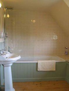 Tongue and groove bath panel with tiling. Bathroom Paneling, Wood Paneling, Small Bathroom, Bathrooms, Bathroom Ideas, Bathroom Tubs, Bathroom Inspo, White Bathroom, Vintage Bathtub