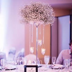 baby's breath centerpiece with hanging crystal beads and candles..inexpensive and pretty.