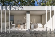 Two shipping containers contain a micro home furnished with Nendo - Casa Container by Marilia Pellegrini