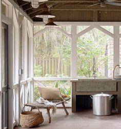 Old bench, stone sink, big windows; eclectic kitchen by Linn Gresham Haute Decor.