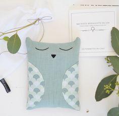 Image of Bouillotte chouette bleu/vert en graines de lin