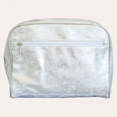 Metallic silver lends subtle glimmer to a glamorous, spacious cosmetic case featuring a zipped exterior pocket that makes it easy to organise your essentials, and the perfect travel accessory.
