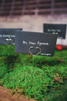 place cards resting in a bed of moss  Photography by tinywater.com, Floral Design by asieldesign.com, Event Coordination by 8events.com