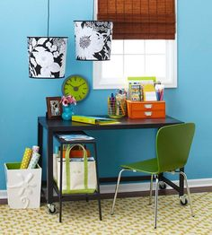 Some creative ideas in this home office-like using a pretty trash bin to hold tall items.  This would work great: http://store.franklinplanner.com/store/category/prod410156/US-Design-Ideas-Vinea/Vinea-WasteCan-by-Design-Ideas