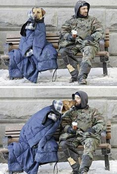 Homeless man uses what little he has to keep his grateful homeless dog warm. Strong bond between them.